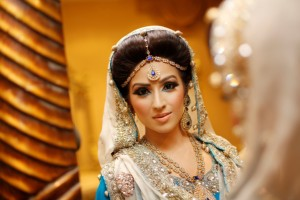 A traditional Asian Bride during her Bridal Photo shoot. Wearing traditional Asian Wedding dress and Asian Bridal Makeup