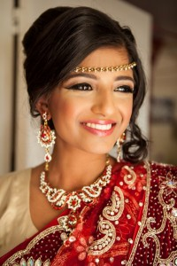 Bengali Bridesmaid wearing traditional attire and makeup with jewelry.