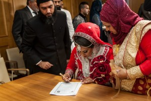 Nikah form being signed by a Bengali Bride on her wedding day.