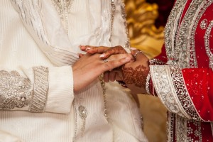 Bengali bride and groom holding hands on their wedding day