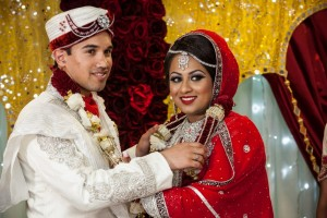 Bengali Bride and Groom exchanging garlands on their wedding day