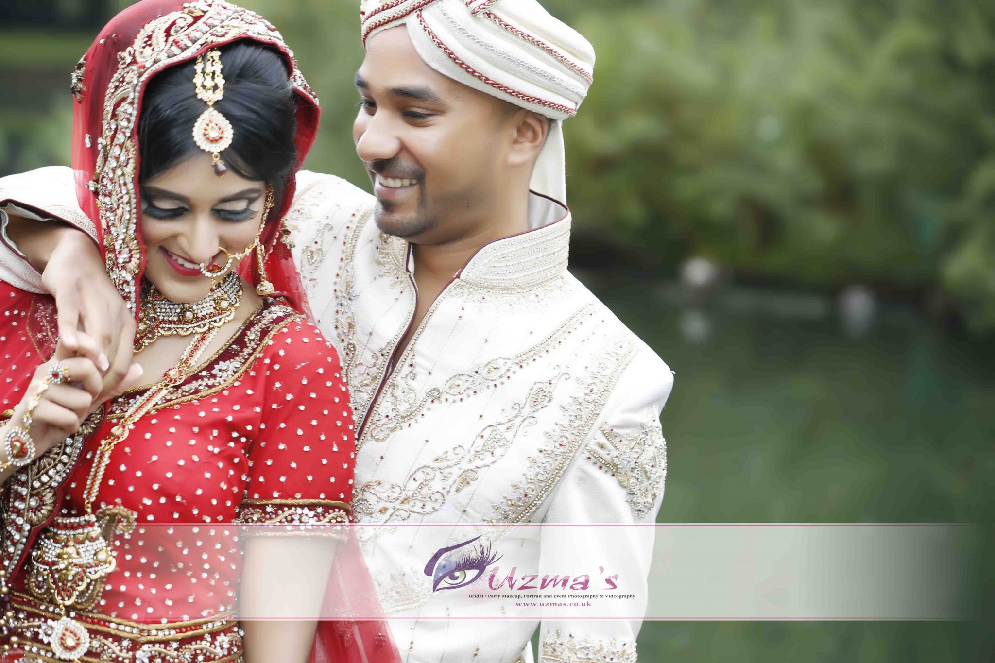 Asian Wedding Photography in UK groom embracing bride - Asian Wedding Uk Magazine