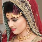 Asian Bride Wearing Traditional Wedding Clothes and Jewelry