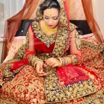 A picture of an Asian Bride Wearing traditional wedding dress