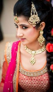 Indian or Pakistani bride showing off her hair style on wedding day